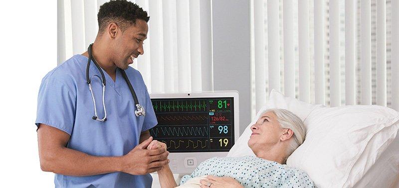 Certified EKG Technician Helping Woman